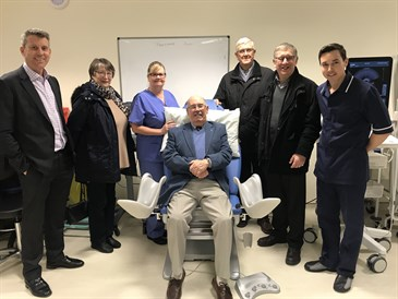 Members of PCSA Kent with the medical chair they have donated